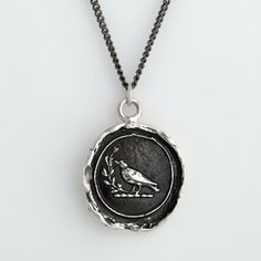 """""""Creativity"""" talisman necklace from Pyrrha. All Pyrrha talisman necklaces are handcrafted from reclaimed sterling silver or bronze using the traditional method of lost wax casting. Rich in symbolism, all of their handcrafted jewelry is designed and made with the use of 18th- and 19th-century wax seals and is rich with meanings culled from heraldry."""