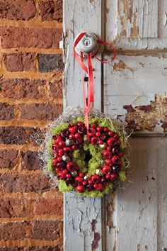 Berries and jingle bells dress up this tiny, layered wreath.