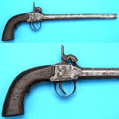Rare late Edo period to Meiji period Japanese .50 cal. box lock percussion pistol patterned after European and American types, partially cleaned steel surfaces, typical simple scroll engraving and chisel carved texture on hardwood handle. This is a very interesting transitional pistol that was manufactured for a short period while the matchlock was being phased out. 38.8 cm. overall.