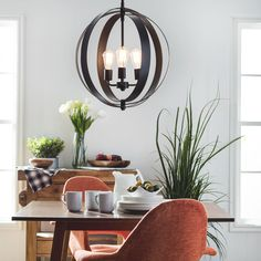 A trendy combination of contemporary design with retro inspiration, this beautiful Cassidy chandelier features a black-finished metal orb housing three Edison-style lights for a versatile addition to any home decor.