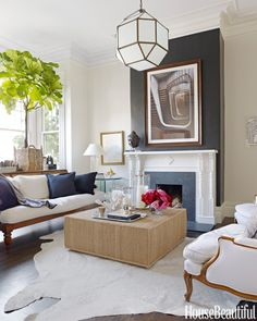 Beauitful living room with Ralph Lauren's black Yacare Crocodile wallpaper on the chiminey
