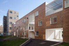 The buildings are made of reinforced concrete and are faced with pink-hued brick. Contemporary Architecture, Architecture Design, Axonometric View, Brick Cladding, Urban Fabric, Social Housing, Concrete Structure, Duplex House, Building Systems