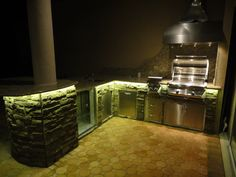Beautifully lit outdoor kitchen. #LED #outdoorkitchen