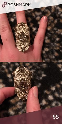 Cute Detailed Ring Never worn detailed ring with flowers and diamonds attached Jewelry Rings