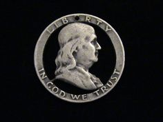 I hand cut good old, Benjamin Franklin out of a silver, US half dollar coin, and this is what it looked like when I was done. Please disregard some, or all, of that statement, and enjoy the cut coin jewelry.