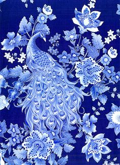 """Navy, Periwinkle, Mist, Ice Blue, White, Marine Blue, Silver Metallic Radiant peacocks display their stunning tail feathers as they wander among stylized jewel toned blossoms, all sparkling with a silver metallic etching. This extravagant collection centers around the iridescent plumage of the beloved peacock that reaches across cultures, myths, and history to bring us a timeless and lasting beauty. Peacocks are about 13"""", with silver metallic, from the 'Plume' collection by Timeless…"""