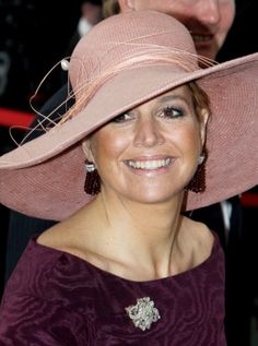 Queen Maxima of the Netherlands, wearing a large brimmed hat.