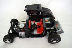 "https://flic.kr/p/FZzzbq | Black coupe - chassis and the body | This is another motorized and remotely controlled hot rod - 100% LEGO VIDEO: www.youtube.com/watch?v=DjPqg0OhQlA Regarding size and functions it is somewhere in between my models ""Fire bucket"" and ""Lucky 13"". Dimensions: 41 studs long, 19 studs wide, 13 – 14.5 studs high and weighs 804 g. PF components: 1 L motor - driving, 1 M motor - steering, 1 8878 battery, 1 IR receiver Motorized functions: driving and steering Other…"