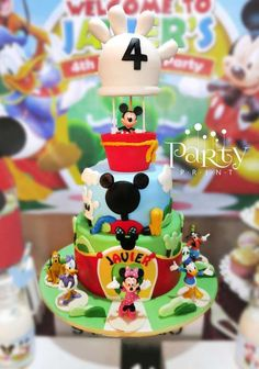 Awesome cake at a Mickey Mouse Clubhouse birthday party! I like the middle layer of this cake.