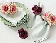 DIY Flower napkin holders...faux flowers glued or sewn onto ponytail holders..SO CHEAP!!