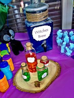 "Brave Birthday Party! I bought the glass containers from hobby lobby and the twine around the top. Koolaid colors for the ""potions""  Printed the words on cream paper and burnt the sides with a lighter to make an ""old map"" type end"