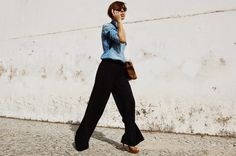 A light blue denim shirt and black wide leg pants are the kind of a winning off-duty combo that you need when you have no extra time to spare. If you don't know how to finish, a pair of brown leather heeled sandals is a foolproof option. Brown Suede, Brown Leather, Dark Brown, Blue Denim Shirt, Denim Shirts, Pumps Heels, Heeled Sandals, Looking For Women, Wide Leg Pants