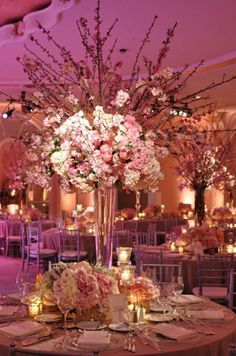 The only thing I would do differently is change out the pink flowers with jewel tone flowers and put candelabras around it.