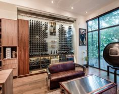 Modern wine cellar featuring the Cable Wine System by Papro Consulting 111b