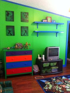 Ninja turtle room finally finished with spray painted dresser and canvas. Fresh painted walls in colors he picked.