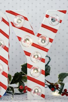 Make these adorable Candy Cane Marquee Letters with this easy tutorial by Melissa from Polka Dot Chair for Tatertots and Jello