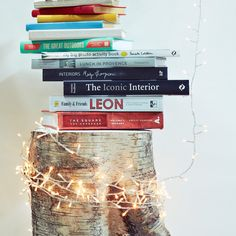 A fairy light lit room with your fave books -, perfection!