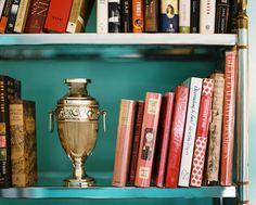 Bookshelf Photo - Books arranged on a mirrored shelf