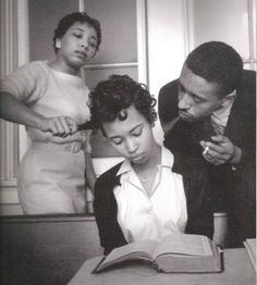 In this famous photograph by Eve Arnold, a young activist is trained not to react to provocation at a 1960 civil rights training session in Virginia.