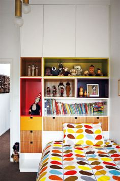 A mix of open shelves and cupboards adds statement storage in the daughter's compact bedroom.