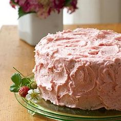 This three-layer strawberry cake gets its delicious flavor from chopped fresh strawberries and strawberry gelatin. Slather with the homemade strawberry buttercream frosting for a rich cake that's truly out of this world.