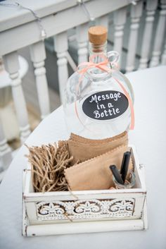 Guests were asked to write messages on fabric squares and place them in a glass bottle for the bride and groom to read later. Venue: The Dream, Twiddy & Company Realty Event Planner: Leslie Cecchini