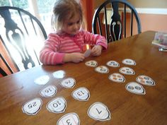 Alligator coin counting to go with The Lady with the Alligator Purse; other preschool activities included.