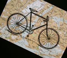 May is National Bike Month - where do you want to go?  Bicycle on vintage New York City map; by CrowBiz