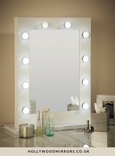 Hollywood Mirror In White Gloss | Makeup Mirror with Lights | Dressing Table Mirror with Lights | Vanity Mirror with Lights | Illuminated Makeup Mirror | Holllywood Mirror UK | Light Up Makeup Mirror | Hollywood Mirrors | Mirror Size 80 X 60cm | https://www.hollywoodmirrors.co.uk/products/makeup-vanity-mirror-with-lights-for-sale The ultimate makeup mirror with 10 led light bulbs & an optional white high glossy stand for when used in the freestanding portrait position on your dressing table.