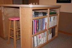 Sewing room - Bookshelf under cutting table