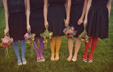 Though their dresses are black, these 'maids wear a rainbow of colorful tights to set them apart