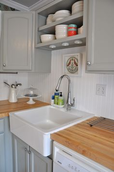 White beadboard backsplash with my light grey cabinets and my farmhouse sink-can't decide if I like the white or if I would paint the beadboard the wall color