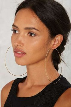 Get your hoops up. The Inner Circle Earrings feature thin gold oversized hoops with latch back closure. Pair em with a low bun and no-bullshit vibe.  Synthetic Materials Imported