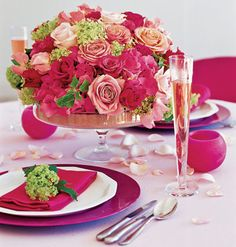 Create a stunning pink theme on a budget with inexpensive plastic pink chargers, simple cloth napkins, and a bouquet of complementary roses.