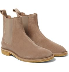 These Chelsea boots by esteemed Italian label Bottega Veneta are an elegant, dependable style that will feature in your footwear offering for years to come. They're exquisitely crafted from beige suede with a comfortable crepe rubber sole. The hue looks great against similarly earthy tones or dark denim.