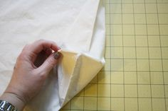 I'll stick with my version of the gusset corner. Measure 1.5 inches from the corner tip up the side seam and along the bottom seam and mark them. Then draw a straight line between them.  Sew that resultant diagonal one, trim off excess and voila!  Gusset Corner!