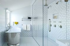 The master bath's subway tile, tub, and fittings are all by Waterworks.