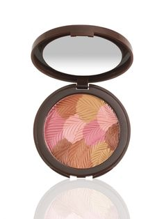 All-over buildable bronzer blush infused with color-correcting colored clay.