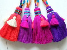 These stunning ethnic Thai tassels make a great addition to bags, accessories or home décor items. Choose from four different shades!* The tassels reflect the Thai people's love of rich, bold colours. Perfect for festival fashion or boho designs! Boho Designs, Pom Pom Crafts, Yarn Crafts, Fabric Jewelry, Handicraft, Decorative Items, Hand Embroidery, Tassels, Sewing Projects