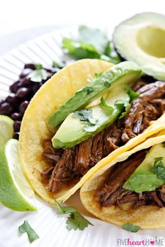 Slow Cooker Beef Barbacoa ~ flavored with smoked chipotles in adobo, fresh garlic, cilantro, and Mexican spices, this tender, juicy meat is an ideal filling for tacos, burritos, and quesadillas, or a tasty topping for rice bowls and salads   FiveHeartHome.com