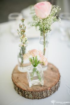 Beautiful wedding table centerpiece in pink with rustic touch.