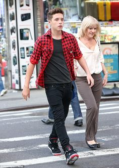 Cool and casual: Brooklyn looked just like his dad David as he walked through Times Square...