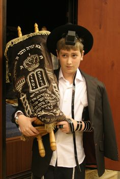 "At age 12, Jewish boys have a coming of age ceremony called a "" Bar Mitzah."" They wear philacteries, and various Jewish clothing wear. They're considered young men at this point"