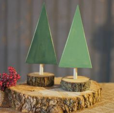 Set of 2 Wood Christmas Trees.. Rustic Primitive Christmas Decor.  With Log Slice Bases and Wooden Dowels Holding up Tree Shaped Wood.  Hand Painted