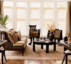 lots of natural light and dark wood furniture work perfectly together