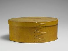 Shaker made oval shaped box in yellow painted pine and maple, New Lebanon, NY.