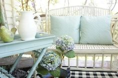 Front porch in light blues and green       Old Lucketts Store - Design House