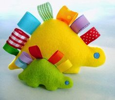 Dinosaur stuffy toys! Thinking tactile toy with some added texture and a crinkle layer and maybe pockets...