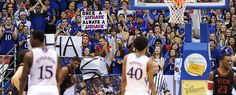 """Kansas fan holds a sign the reads """"Once a Jayhawk, always a Jayhawk"""" during the second half of the match against Texas Tech Monday night March 4 in Allen Fieldhouse. Kansas defeated the Red Raiders 79-42."""