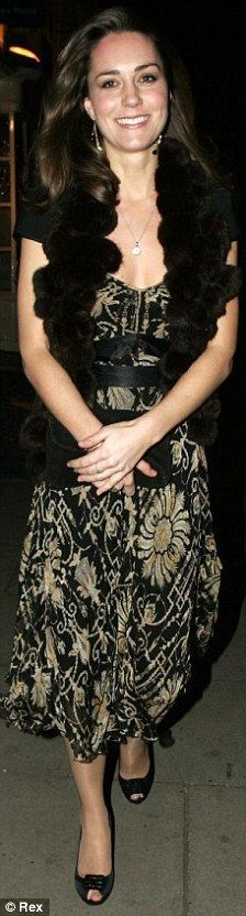 November 30th, 2006 - Kate was spotted leaving Mamilanji nightclub looking very dolled up. She wore a gold and black floral dress with a fur shrug and black clutch. Finally paired with, her Asprey Button Pendant.